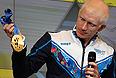 Российский спортсмен Федор Триколи на презентации комплекта медалей Олимпийских и Паралимпийских игр 2014.