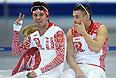 Слева направо: Евгений Серяев и Денис Коваль (Россия) на тренировке перед началом XXII зимних Олимпийских игр в Сочи.
