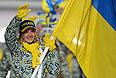 Знаменосец сборной Украины Валентина Шевченко во время парада атлетов и членов национальных делегаций на церемонии открытия XXII зимних Олимпийских игр в Сочи.