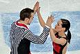Ксения Столбова и Федор Климов (Россия) выступают в произвольной программе парного катания командных соревнований по фигурному катанию на XXII зимних Олимпийских играх в Сочи.