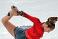Юлия Липницкая (Россия) выступает в произвольной программе женского одиночного катания на соревнованиях по фигурному катанию.