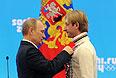 Путин принял участие в церемонии награждения российских призеров Олимпиады в Сочи
