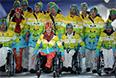 Представители Германии во время парада атлетов и членов национальных делегаций на церемонии открытия XI зимних Паралимпийских игр в Сочи.