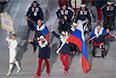 Представители России во время парада атлетов и членов национальных делегаций на церемонии открытия XI зимних Паралимпийских игр в Сочи.