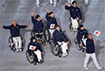 Представители Японии во время парада атлетов и членов национальных делегаций на церемонии открытия XI зимних Паралимпийских игр в Сочи.