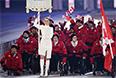 Представители Канады во время парада атлетов и членов национальных делегаций на церемонии открытия XI зимних Паралимпийских игр в Сочи.