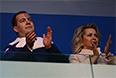 Председатель правительства РФ Дмитрий Медведев с супругой Светланой во время театрализованного представления на церемонии открытия XI зимних Паралимпийских игр в Сочи.