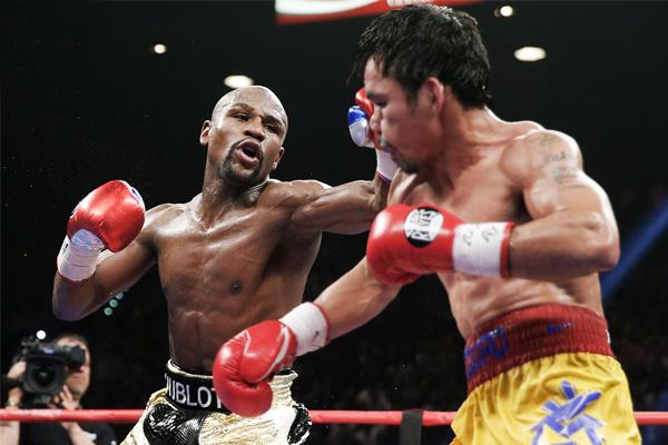 Американский боксер Флойд Мэйуэзер (слева) - $300 млн