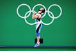 Штангист из Азербайджана, выступающий в составе сборной Казахстана Ниджат Рахимов стал победителем олимпийского турнира по тяжелой атлетике в весовой категории до 77 кг с мировым рекордом в толчке - 214 кг