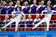 Северокорейские болельщицы на соревнованиях по хоккею среди женщин между Швецией и объединенной командой Северной и Южной Кореи. Команда и в этой игре потерпела поражение со счетом 0:8.