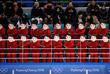 Девушки-чирлидеры из КНДР в масках во время матча объединенной женской команды Кореи по хоккею против Швейцарии. Сборная Кореи проиграла со счетом 0:8.