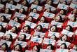 Группа поддержки сборной КНДР во время соревнований по шорт-треку среди женщин