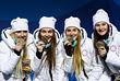 Анна Нечаевская, Анастасия Седова, Юлия Белорукова и Наталья Непряева (слева направо) принесли России бронзу в лыжной эстафете, а Белорукова также завоевала медаль аналогичного достоинства в индивидуальном спринте