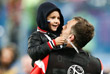 Игрок сборной России Артем Дзюба с сыном после победы команды в матче группового этапа чемпионата мира по футболу между сборными России и Египта