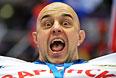 Болельщик в матче группового этапа между сборными командами России и Словении на соревнованиях по хоккею среди мужчин на XXII зимних Олимпийских играх в Сочи.