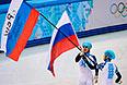Слева направо: Владимир Григорьев и Виктор Ан (Россия) радуются победе в финальном забеге на 1000 метров в соревнованиях по шорт-треку среди мужчин на XXII зимних Олимпийских играх в Сочи.