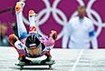 Сергей Чудинов (Россия) на старте в третьем заезде на соревнованиях по скелетону среди мужчин на XXII зимних Олимпийских играх в Сочи.