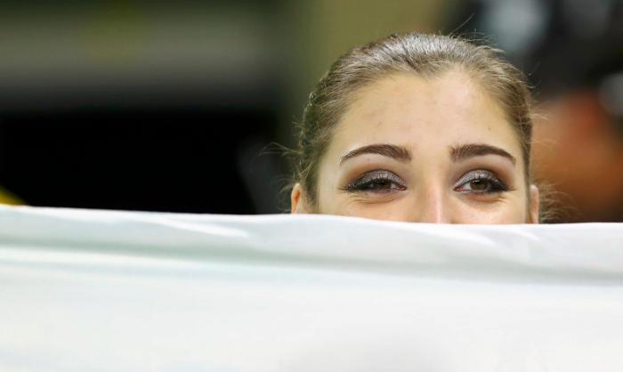Российская гимнастка Мустафина завоевала золото ОИ в упражнениях на брусьях